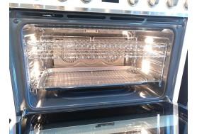 Голяма свободно стояща печка SMEG CPF9GMR с голяма 90см фурна и 6 газови котлона в червено и неръждаема стомана
